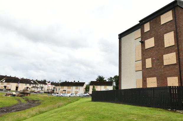 Houses have been boarded up beside the bonfire in the Corcrain Area of Portadown. Credit: Pacemaker