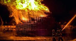 The Corcrain Redmanville bonfire in Portadown is lit on July 10th 2019 (Photo by Kevin Scott for Belfast Telegraph)