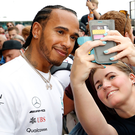 In frame: Lewis Hamilton poses with a fan ahead of his bid to tame Silverstone once again and extend his title advantage