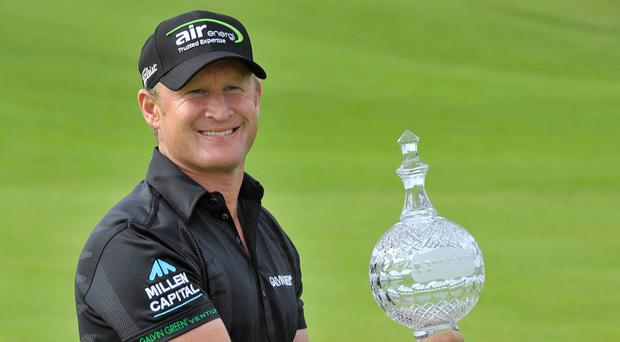 Happy times: Jamie Donaldson with the Irish Open trophy at Royal Portrush in 2012