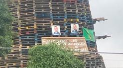 Posters of DUP councillor David Ramsey on a bonfire in Londonderry. Credit: Leona O'Neill