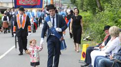 Andrew Black with his daughter Esme during the 12th demonstration in Pomeroy as it hosts the largest Twelfth parade in Co. Tyrone on the 12th of July 2019 (Photo by Peter Morrison)