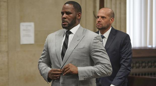 R Kelly is being held at the high-rise Metropolitan Correctional Centre in downtown Chicago (E. Jason Wambsgans/Chicago Tribune via AP, Pool)