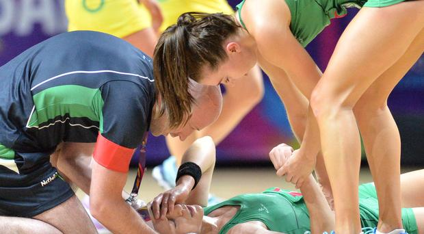 Big blow: NI skipper Caroline O'Hanlon receives treatment after injury in World Cup opener against Australia in Liverpool