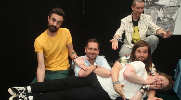 Members of Bastille pose backstage with singer Lewis Capaldi ahead of his guest appearance with the band on the Pyramid Stage at Glastonbury (Yui Mok/PA)