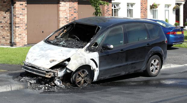 The arson attack on a car in the Lagmore View Road area of Dunmurry during the early hours of Sunday July 14.