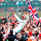 Simply fantastic: Lewis Hamilton celebrates with the British supporters