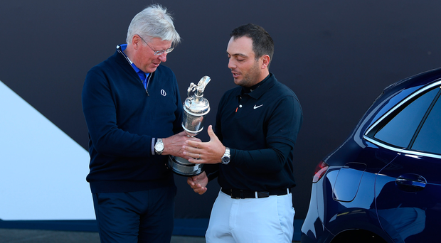Handing over: Francesco Molinari returns the Claret Jug to Martin Slumbers, Chief Executive of the R&A