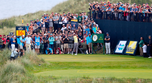 Taking aim: Tiger Woods tees off at the 16th during a practice round at Royal Portrush