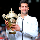 Just champion: Novak Djokovic proudly shows off his Wimbledon title