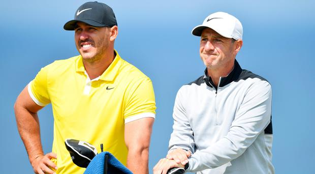 Portrush-born caddie Ricky Elliott is showing his man Brooks Koepka round his home town this week.