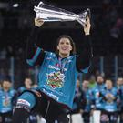 Belfast Giants defenceman with the Elite League trophy (William Cherry/Presseye)