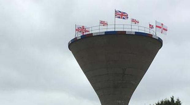 Flags have been erected on the top of a water tower in Rathfriland. Credit: Chris Hazzard