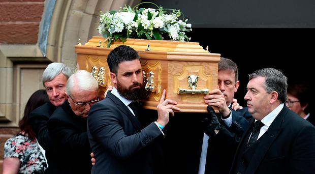 The coffin of Sir Anthony Hart is carried by his son David Hart (front left), from St Mark's Church of Ireland, Dundela. Photo credit: Liam McBurney/PA Wire