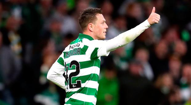 Celtic's Callum McGregor celebrates scoring his side's second goal of the game during the UEFA Champions League first qualifying round, second leg match at Celtic Park. Photo credit: Andrew Milligan/PA Wire