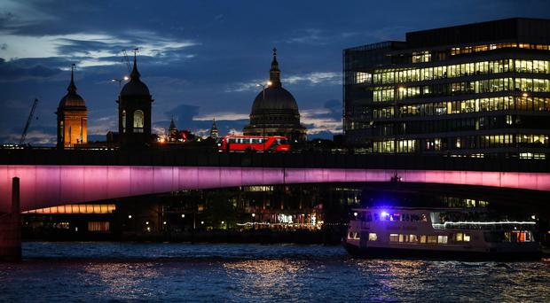 London Bridge, one of four bridges which have been transformed to launch the first phase of Illuminated River (Matt Alexander/PA)