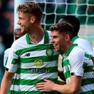 Happy Hoops: Ryan Christie (right) celebrates his goal last night with Kristoffer Ajer