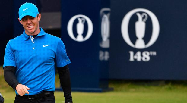 Northern Ireland's Rory McIlroy walks down the fairway from the first hole during the first round of the British Open golf Championships at Royal Portrush golf club in Northern Ireland on July 18, 2019. (Photo by Paul ELLIS / AFP) / RESTRICTED TO EDITORIAL USEPAUL ELLIS/AFP/Getty Images
