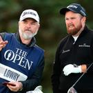 Republic Of Ireland's Shane Lowry (right) during day one of The Open Championship 2019 at Royal Portrush Golf Club. PRESS ASSOCIATION Photo. Picture date: Thursday July 18, 2019. See PA story GOLF Open. Photo credit should read: Richard Sellers/PA Wire. RESTRICTIONS: Editorial use only. No commercial use. Still image use only. The Open Championship logo and clear link to The Open website (TheOpen.com) to be included on website publishing.