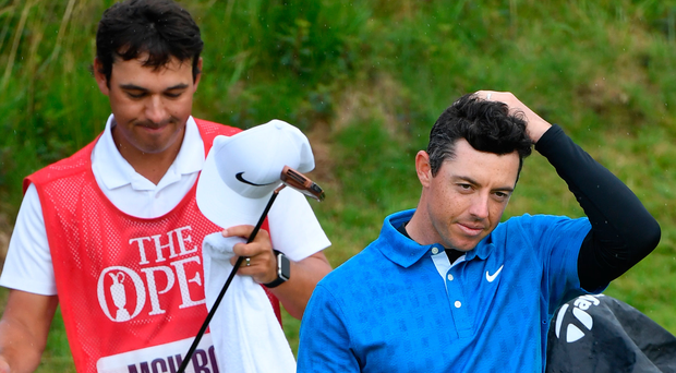 Major disappointment: A frustrated Rory McIlroy on the 18th green with his caddy Harry Diamond