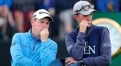 Robert MacIntyre speaks to his caddie at The Open Championship at Royal Portrush (Richard Sellers/PA)