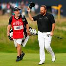 Shane Lowry walks down the 18th hole at Royal Portrush with caddie Brian 'Bo' Martin at The Open Championship (Francois Nel/Getty Images)