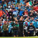 Ireland's Shane Lowry celebrates as he walks up the 18th fairway during the final round of the British Open golf Championships at Royal Portrush golf club in Northern Ireland on July 21, 2019. (Photo by Andy BUCHANAN / AFP) / RESTRICTED TO EDITORIAL USEANDY BUCHANAN/AFP/Getty Images