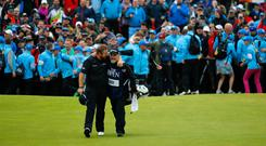 Teamwork: Shane Lowry puts his arm around caddy Brian Martin as the pair walk onto the 72nd green at The Open Championship.