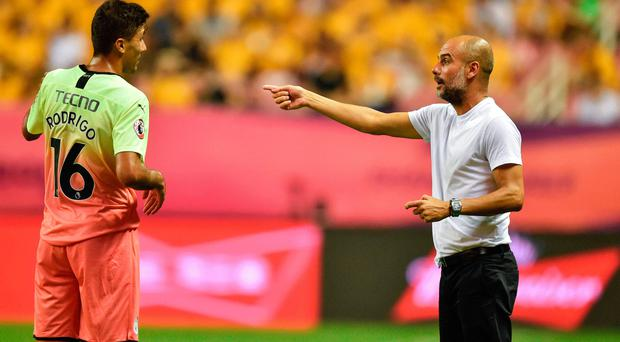 Point made: Pep Guardiola instructs his midfielder Rodrigo during the clash against Wolves