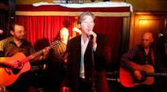 Ulster actor Adrian Dunbar in McHugh's bar in Belfast, where he performed with his band, the Jonahs, as part of the Cathedral Quarter Belfast Eighth Open House Festival, 2006.Picture: Paul Faith/PA