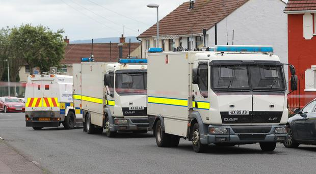 Police at the scene of a security alert in west Belfast. Credit: Kevin Scott