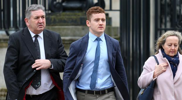 Peter Jackson with his son Paddy Jackson outside court. Picture By: Pacemaker.