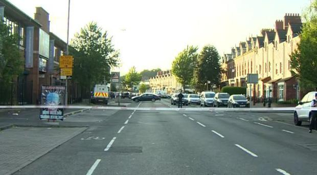 The scene of the shooting on the Springfield Road in Belfast. Credit: BBC