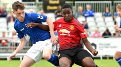 Blue on red: Man United's Jovani Molenge in action with Lewis MacKinnon of Rangers in last summer's SuperCup junior section