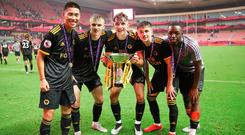 Golden boys: Terence Taylor and his Wolves team-mates celebrate after winning the Premier League Asia Trophy