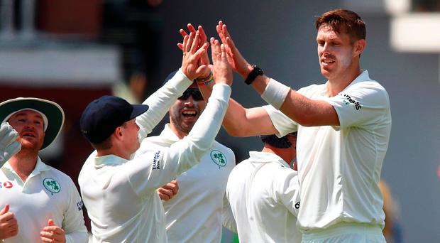 Team effort: Ireland's Boyd Rankin is congratulated by his team-mates after taking the wicket of Sam Curran
