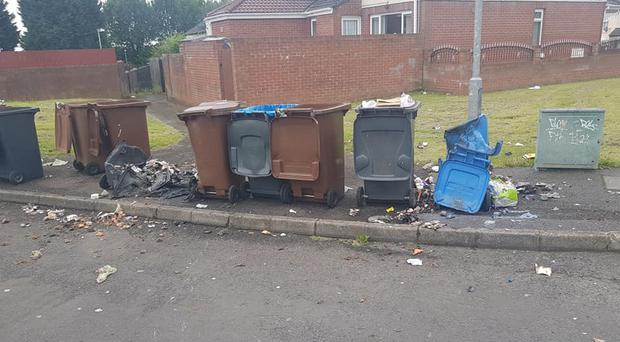 A number of wheelie bins were set on fire in the Poleglass area on Thursday morning. Credit: Stephen Magennis.