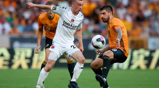 Wolverhampton Wanderers' Ruben Neves and Crusaders' Paul Heatley battle for the ball during the Europa League Qualifying match at Molineux, Wolverhampton. PRESS ASSOCIATION Photo. Picture date: Thursday July 25, 2019. See PA story SOCCER Wolves. Photo credit should read: Nick Potts/PA Wire
