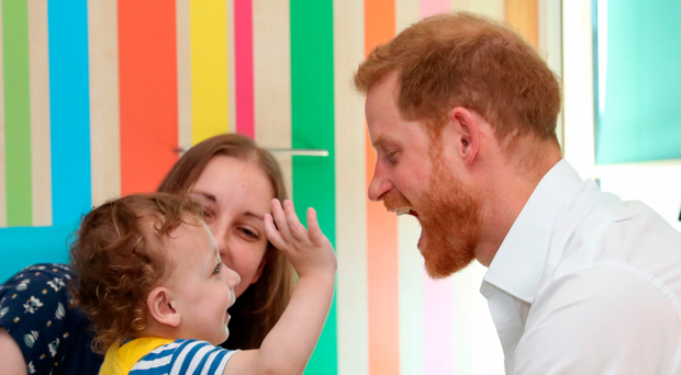 The Duke of Sussex plays with one year-old Noah Nicholson at Sheffield Children's Hospital where he officially opened the new wing