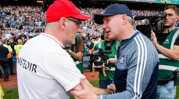 Old rivals: Tyrone boss Mickey Harte is consoled by Jim Gavin of Dublin after defeat in last year's All-Ireland final