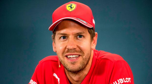 Real struggle: Sebastien Vettel is 100 points off the title pace