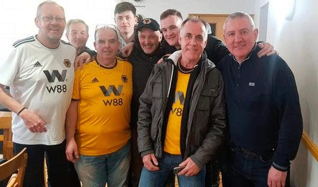 Main attraction: Robbie Dennison with a group of Wolves supporters from Northern Ireland