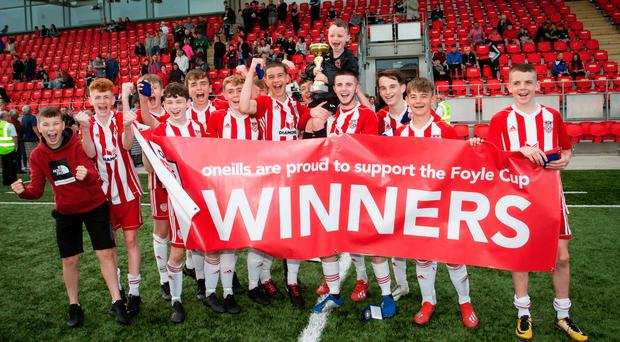 Just champion: Derry City celebrate their narrow 1-0 triumph over Donegal side Finn Harps at the Brandywell in the Foyle Cup Under-15 final