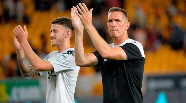 Big hand: Jordan Forsythe and Stephen Baxter applaud the visiting fans at Molineux