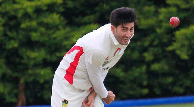 On target: Haseeb Azam won the bowl-out as holders Waringstown reached the semi-final of the Irish Senior Cup for a fifth successive year