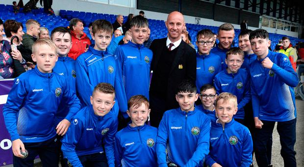 Star power: Players from Warrenpoint Town welcome Manchester United legend Nicky Butt to the Coleraine Showgrounds