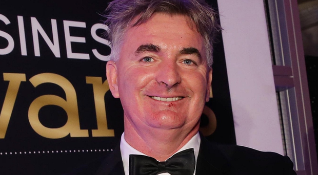 Brian Conlon from First Derivatives with his Belfast Telegraph Business Award for Businessperson of the Year 2015
