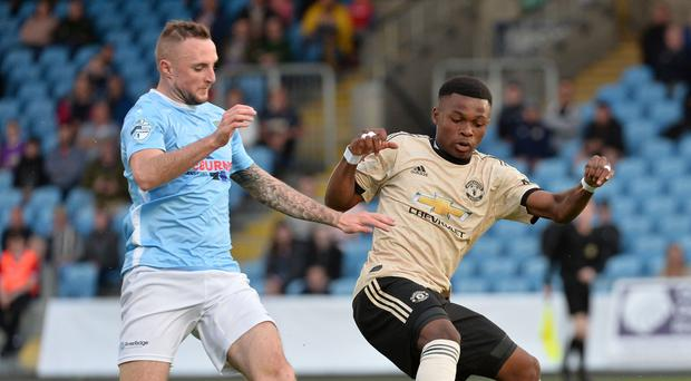 Ballymena United's Jude Winchester and Manchester United's Largie Ramazani during the game at the Ballymena Showgrounds. Pic Colm Lenaghan/Pacemaker