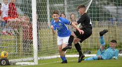 Glenavon's Jack Kerr celebrates after he scores the equaliser on route to his side's 2-1 comeback victory over Greenisland.