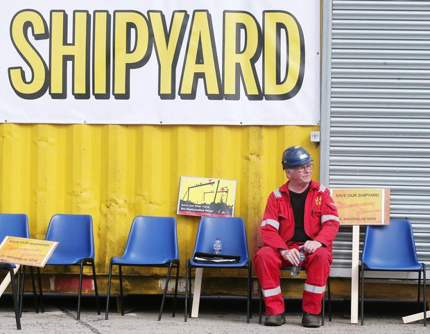 Workers continue their protest at the entrance to Harland and Wolff in Belfast where they say they plan to stay until the shipyard is privatised. Credit: Jonathan Porter/PressEye